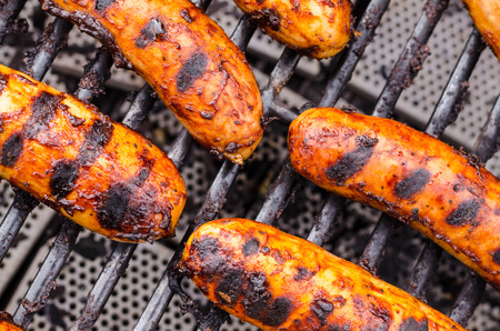 Sausage covered in sauce on grill Banco de Imagens - 31025787
