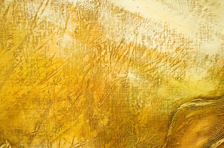 Abstract painted textured background in yellow color. photo
