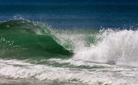 splutter: Ocean wave with splash of water in clear day