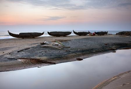 Vakala beach with fishing ships at the sunset photo