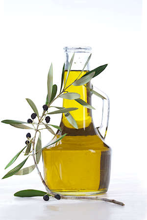 carafe: Olives, oil and a blossoming branch of an olive tree. Isolated on a white background
