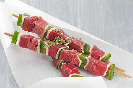 backing: Fresh raw skewers in backing paper
