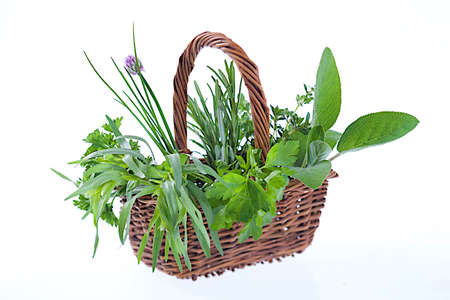 Little basket of  aromatic herbs  on white  background photo