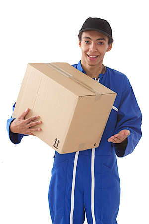 Young courier boy moving boxes looking away  Great services  photo