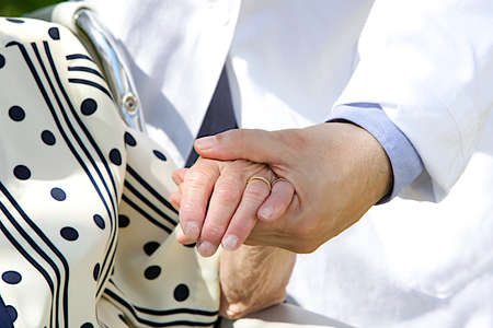 care giver: image of Compassionate hands  Stock Photo