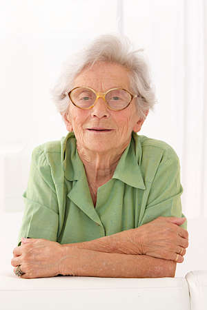 congenial: Portrait of a Senior lady with eyes glasses,white background with white hair