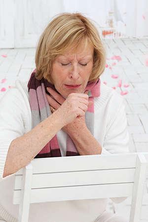 bronchitis: Senior Blond Woman coughing  Stock Photo