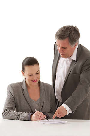 Image of business man  pointing document to businesswoman   for signature  at the office photo