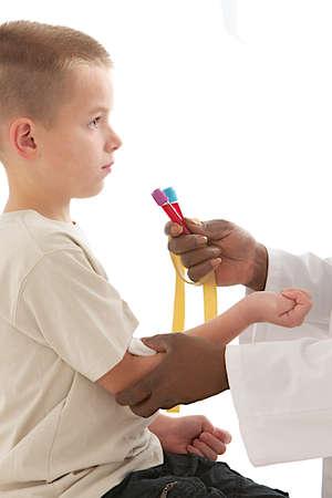 Laboratory blood sample on kids  photo