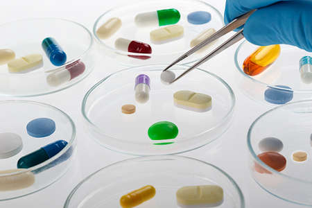 Assortment of colored pills and capsules of Medication varied sampler, pills, tablets and drugs  photo