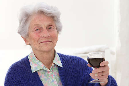 mother in law: Senior woman holding glass of wine