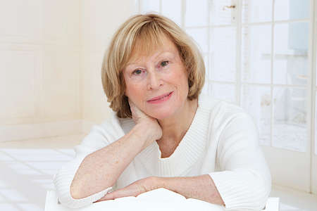 beautiful middle aged woman: beautiful middle aged woman sitting at home