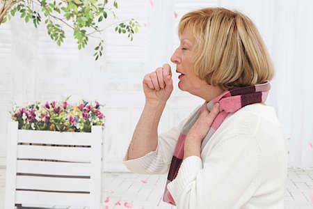 bronchitis: Senior Woman coughing  Stock Photo