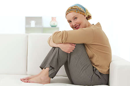 Portrait of a beautiful, courageous cancer patient in a head scarf at home    Stock Photo