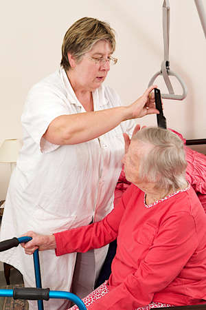 care giver: Care giver, combing hair to elderly woman, at home  Stock Photo