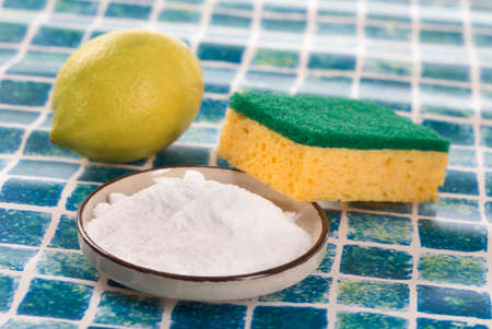 cleaning products: Organic cleaners. White vinegar, lemon and sodium bicarbonate. Stock Photo