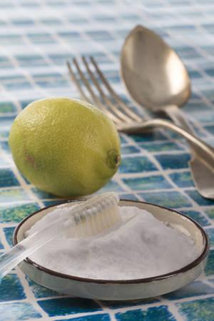 sodium bicarbonate: Organic cleaners. White vinegar, lemon and sodium bicarbonate. Stock Photo