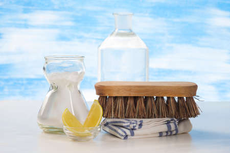 Eco-friendly natural cleaners Vinegar, baking soda, salt, lemon and cloth Stock Photo
