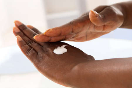 lotions: female hand applying moisturiser