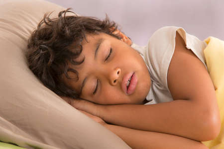 child in bed: Young boy sleeping