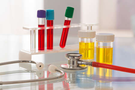 healthcare  and medicine symbole  - Urine Sample and Blood Test and stethoscope Stock Photo