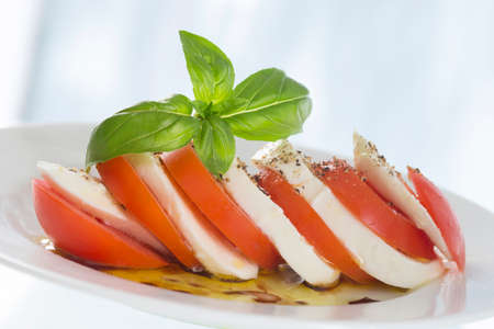 salad greens: Caprese Salad , Tomato Mozzarella Stock Photo