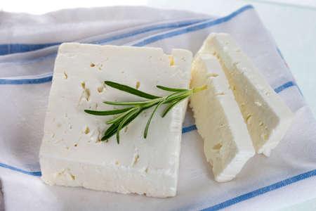 feta cheese: Traditional Greek feta cheese with rosemary Stock Photo