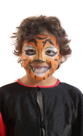 painting face: childrens Carnival, young boy with His Face painted like a tiger