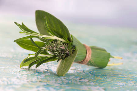 Bouquet garni of fresh herbs, tied with twine. Rosemary, thyme, oregano, parsley