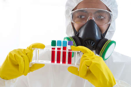 ebola: Scientist in protective wear with blood sample Stock Photo