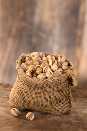 pistachios: roasted salty pistachios nuts in sack bag,above view Stock Photo