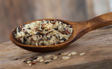 wild rice: Long grain and wild rice mix in wooden spoon