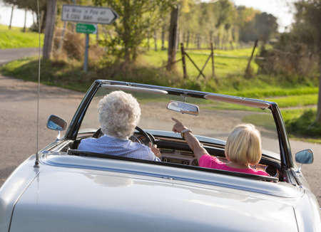 seater: Senior couple in sports car