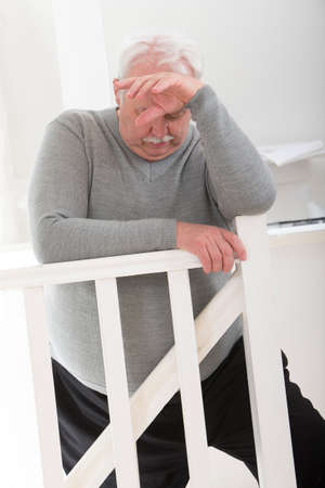 overwrought: obese man looking worried with hand on forehead,looking depress Stock Photo