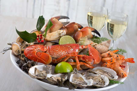 seafood platter with glass of white wine