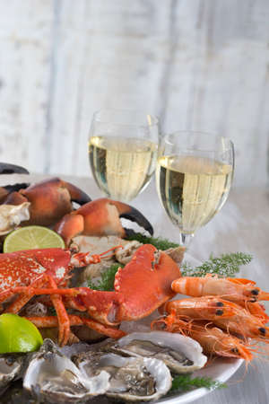 seafood platter with glass of white wine photo
