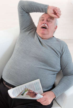 obese man: senior man obese Having a nap