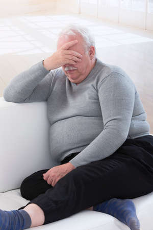 Concerned overweight senior man