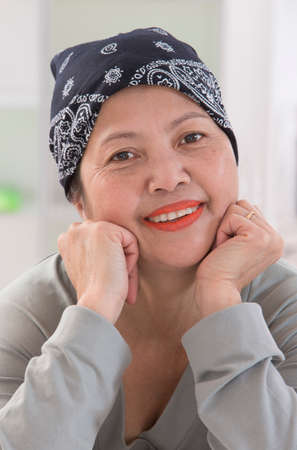 50 to 60: Senior Asian woman wearing Thai headscarff Recovering from cancer