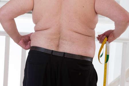 profile measurement: fat man touching his stomach