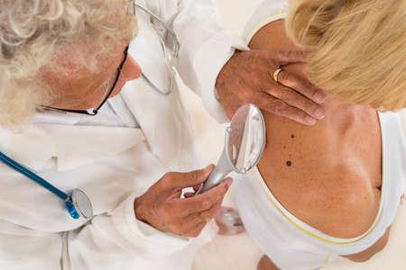 dermatologist focus on senior woman beauty spot 스톡 콘텐츠