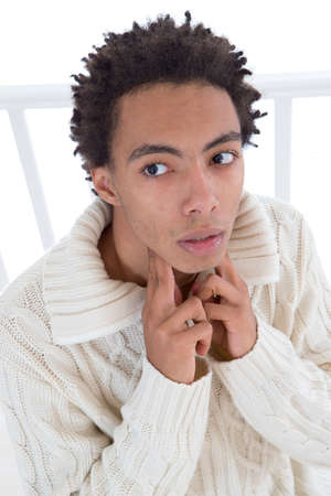 cold sore: YOUNG MAN WITH SORE THROAT MAN Stock Photo