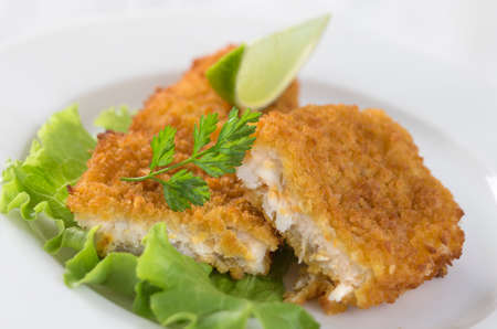 potato cod: fried fish fillet od cod  with salad on white background