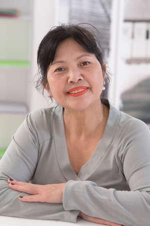 Smiling senior asian thai woman portrait photo