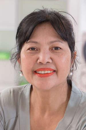 one year old: Smiling senior asian thai woman portrait