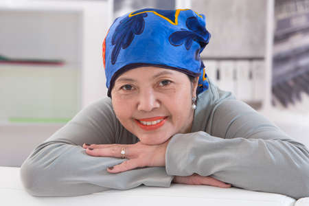 Senior Asian woman wearing Thai headscarff Recovering from cancer photo