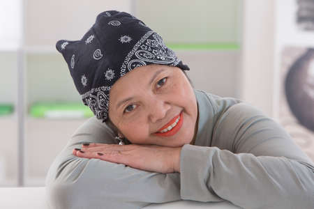 Senior Asian woman wearing Thai headscarff Recovering from cancer