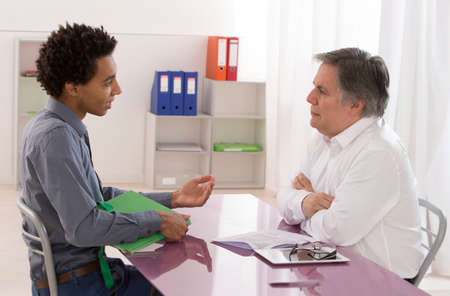 interviewing: jobb interview two men talking Stock Photo