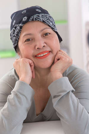 Senior Asian woman wearing Thai headscarff Recovering from cancer Stock Photo