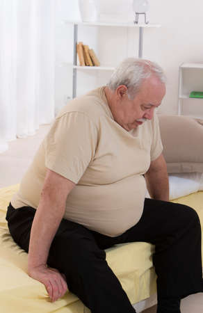 senior eating: Overweight senior man Concerned With His health